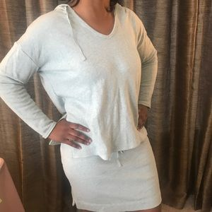 Two piece sweater hoodie and skirt set.